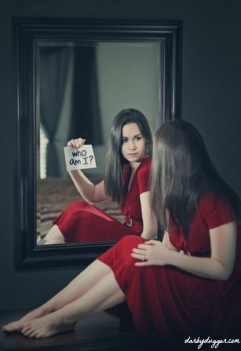 "A woman looking into a mirror and asking ""who am I?"""